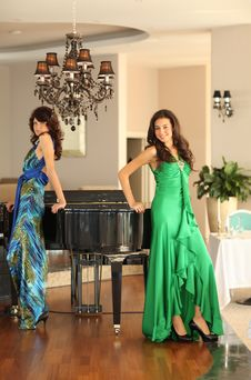 Free Two Beautiful Young Women At A Piano Stock Photo - 17171430