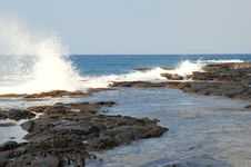 The Pacific Ocean Slamming Against A Tidal Pool Stock Photos