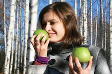 Young Girl With Two Green Apples In The Birch Wood Stock Image