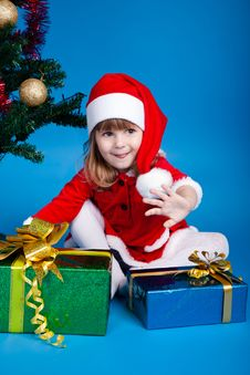 Free Girl In Santa Costume Playing With Gifts Royalty Free Stock Images - 17175739
