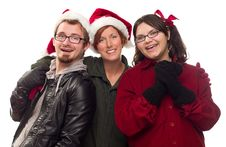 Three Friends Wearing Warm Holiday Attire Stock Photo