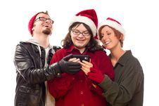 Three Friends Enjoying A Cell Phone Together Stock Photos