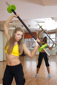 Free Beautiful Girl With Weight Gym Indoors Stock Photos - 17180793