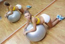 Free Girl In Shorts Do Exercise On Big Ball In Gym Royalty Free Stock Image - 17180906