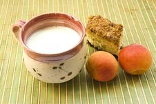 Free A Cup Of Milk Cake And Apricot On The Mat Stock Photography - 17183072