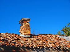 Free Old Tiled Roof With A Small Chimney Stock Images - 17183444