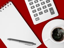 White Calculator And White Note Paper On Red Stock Photos
