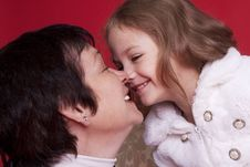 Little Girl With Her Grandmother Stock Photo