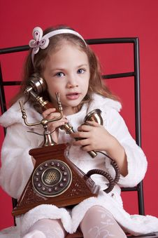 Free Little Girl Talking By Old Phone Royalty Free Stock Photography - 17193547
