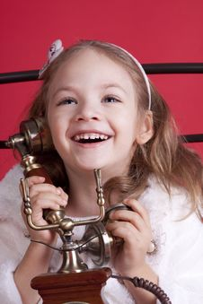 Free Happy Little Girl Talking By Phone Stock Photos - 17193583