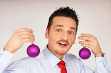Free Young Man Shows Violet Christmas Ornament. Stock Photography - 17194912