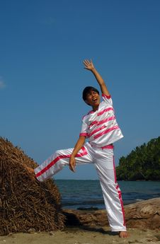 Asian Boy In Dance Costume On The Beach. Stock Image