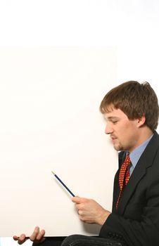 Young Man With Pencil Pointing At Board Stock Photos