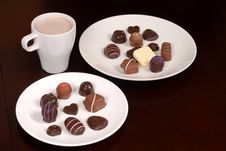Free Two Plates Of Chocolates With A Cup Of Hot Chocolate Stock Photos - 1728473