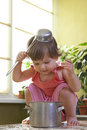 Free Little Girl With A Pan And Ladle On Her Head Royalty Free Stock Images - 17207389