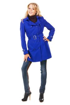 Pretty Model In A Blue Coat Royalty Free Stock Photos