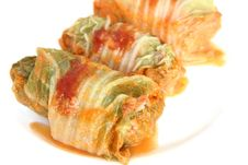 Free Three Stuffed Cabbage With Tomato Sauce On A White Royalty Free Stock Image - 17201166