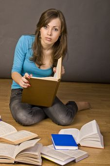 Beautiful Girl Thoughtfully Reading A Book Stock Images
