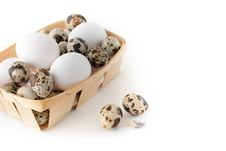 Basket With Eggs On A White Background Royalty Free Stock Photo