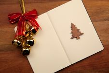 Free Blank Notebook With Christmas Bell Stock Photography - 17204242