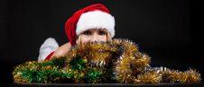 Free Christmas Girl Over Tinsel Stock Photos - 17204353