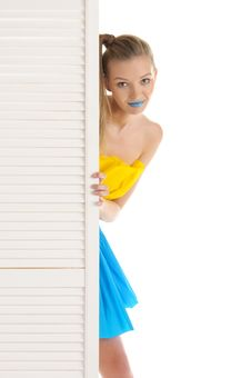 Free Young Woman Looks Out Because Of Door Royalty Free Stock Photography - 17207017