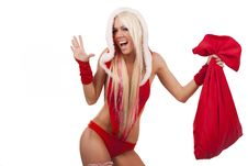 Woman In Santa Claus Suit With Gift Bag Stock Photography