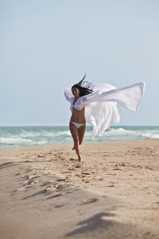 Free The Girl In White Coat At The Beach Royalty Free Stock Photography - 17207357