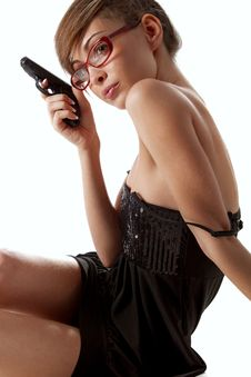 Free Young  Woman In Red Glasses With Handgun Royalty Free Stock Photo - 17207375