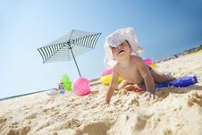 Little Girl On The Sand Beach Royalty Free Stock Photos