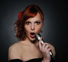 Free Beautiful Singing Redhead Woman Stock Image - 17208621