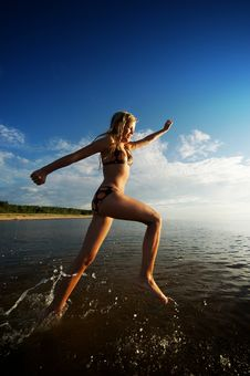 Free Girl Running In The Sea Royalty Free Stock Image - 17208636
