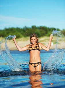 Free Happy Girl Making Water Splashes Royalty Free Stock Photography - 17208647