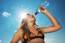 Free Girl Drinking Water Outdoors Royalty Free Stock Photography - 17208667
