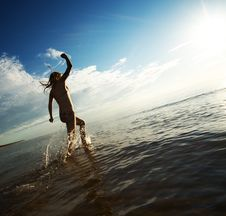 Free Girl Running In The Sea Royalty Free Stock Photo - 17208815
