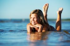 Girl Relaxing In The Water Royalty Free Stock Photos