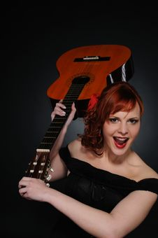 Free Redhead Woman With Guitar Royalty Free Stock Image - 17208996