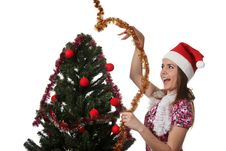 Free Woman Decorate A Christmas Tree Stock Photo - 17209980