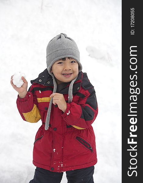Boy with snowball.