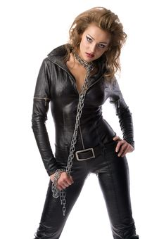 Beauty Woman In Leather Overalls Stock Photography
