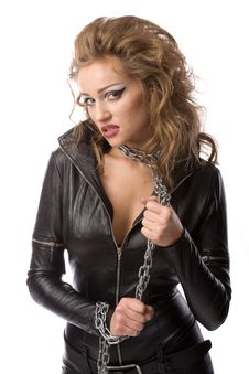 Beauty Woman In Leather Overalls Royalty Free Stock Photos