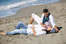 Free Young Couple Enjoying  Picnic On The Beach Royalty Free Stock Photos - 17212598