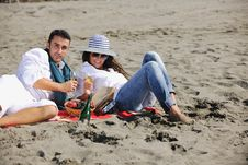 Free Young Couple Enjoying  Picnic On The Beach Royalty Free Stock Photo - 17212625