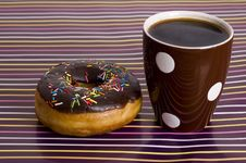 Chocolate Iced Donut And Coffee Royalty Free Stock Photography