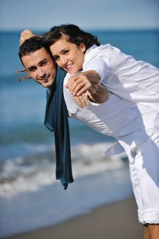 Free Happy Young Couple Have Fun At Beautiful Beach Stock Photos - 17214303