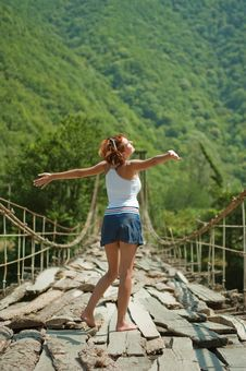 Free Girl On A Mountain Bridge Royalty Free Stock Photography - 17214937