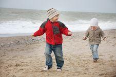Children Running On Beach Stock Image