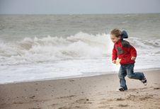 Free Happy Boy Running On Beach Stock Photo - 17215570