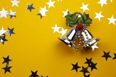 Christmas Bells On The Yellow Background Royalty Free Stock Images