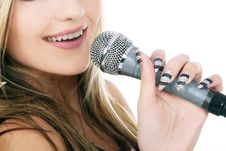 Young Woman With Music Micropone Stock Photos